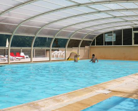The heated swimming pool of the natural campsite Parc du Charouzech in Aveyron